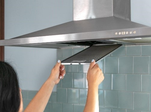 filter being removed from rangehood